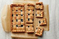 """A bright berry filling and a buttery flaky crust make this hand-held pie totally irresistible. <a href=""""https://www.epicurious.com/recipes/food/views/mixed-berry-pie-bars?mbid=synd_yahoo_rss"""" rel=""""nofollow noopener"""" target=""""_blank"""" data-ylk=""""slk:See recipe."""" class=""""link rapid-noclick-resp"""">See recipe.</a>"""