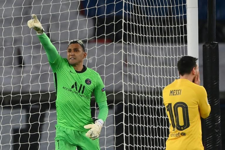 A Keylor Navas save from Lionel Messi's penalty helped secure Paris Saint-Germain's qualification for the Champions League quarter-finals at Barcelona's expense