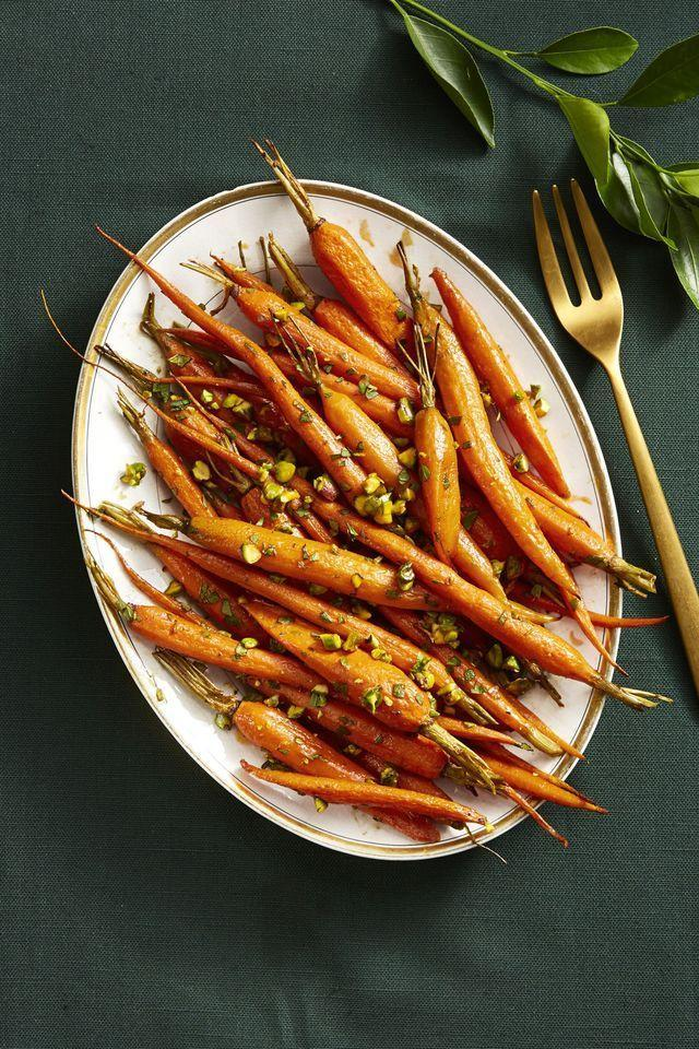 """<p>Sometimes simple and straightforward is best. Here, we toss whole carrots (read: no chopping required!) with olive oil and a few spices, then roast until golden brown and tender. Finish it off with a splash of red wine vinegar and melted butter, plus a sprinkle of chopped pistachios.</p><p><em><a href=""""https://www.goodhousekeeping.com/food-recipes/a14891/spice-roasted-carrots-recipe-ghk1114/"""" rel=""""nofollow noopener"""" target=""""_blank"""" data-ylk=""""slk:Get the recipe for Spice-Roasted Carrots »"""" class=""""link rapid-noclick-resp"""">Get the recipe for Spice-Roasted Carrots »</a></em></p>"""