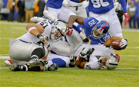 Nov 10, 2013; East Rutherford, NJ, USA; Oakland Raiders running back Rashad Jennings (27) picks up first down against the New York Giants during the first half at MetLife Stadium. Mandatory Credit: Jim O'Connor-USA TODAY Sports