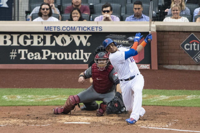 Sep 12, 2019; New York City, NY, USA; New York Mets center fielder Juan Lagares (12) hits a grand slam home run during the third inning against the Arizona Diamondbacks at Citi Field. Mandatory Credit: Gregory J. Fisher-USA TODAY Sports