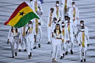 <p>Ghana's flag bearer Nadia Eke leads the delegation during the opening ceremony of the Tokyo 2020 Olympic Games, at the Olympic Stadium, in Tokyo, on July 23, 2021. (Photo by Ben STANSALL / AFP) (Photo by BEN STANSALL/AFP via Getty Images)</p>