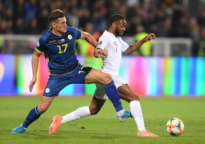 PRISTINA, KOSOVO - NOVEMBER 17: Benjamin Kololli of Kosovo tackles Raheem Sterling of England during the UEFA Euro 2020 Qualifier between Kosovo and England at the Pristina City Stadium on November 17, 2019 in Pristina, Kosovo. (Photo by Michael Regan/Getty Images)