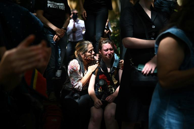 A protester is comforted during a rally against sexual violence and gender inequality in Sydney