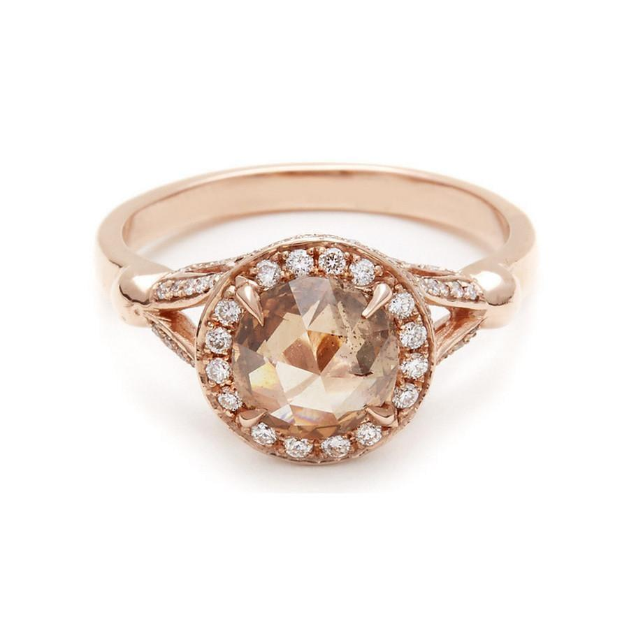 """<p>The <a href=""""https://www.popsugar.com/buy/Anna-Sheffield-Luna-Ring-115545?p_name=Anna%20Sheffield%20Luna%20Ring&retailer=annasheffield.com&pid=115545&price=11%2C185&evar1=fab%3Aus&evar9=44555978&evar98=https%3A%2F%2Fwww.popsugar.com%2Fphoto-gallery%2F44555978%2Fimage%2F44555979%2FAnna-Sheffield-Luna-Ring&list1=wedding%2Cjewelry%2Crose%20gold%2Cengagement%20rings%2Cshopping%20guide&prop13=api&pdata=1"""" rel=""""nofollow noopener"""" class=""""link rapid-noclick-resp"""" target=""""_blank"""" data-ylk=""""slk:Anna Sheffield Luna Ring"""">Anna Sheffield Luna Ring</a> ($11,185) features a champagne-colored diamond, which matches its pretty rose gold band. </p>"""