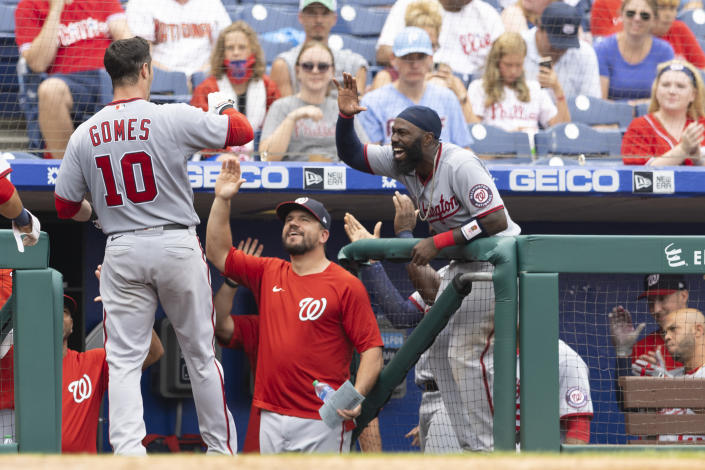 PHILADELPHIA, PA - JULY 29: Yan Gomes #10 of the Washington Nationals celebrates with Josh Harrison #5 after hitting a two run home run in the top of the seventh inning against the Philadelphia Phillies during Game One of the doubleheader at Citizens Bank Park on July 29, 2021 in Philadelphia, Pennsylvania. The Nationals defeated the Phillies 3-1. (Photo by Mitchell Leff/Getty Images)