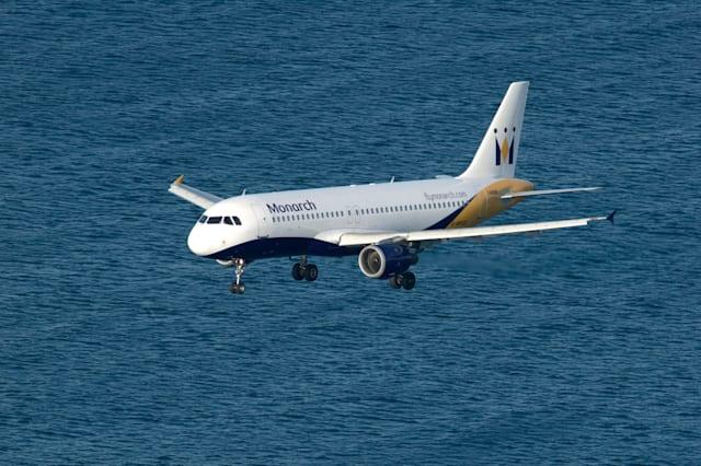 Monarch airlines jet on final approach to Gibraltar over Mediterranean sea