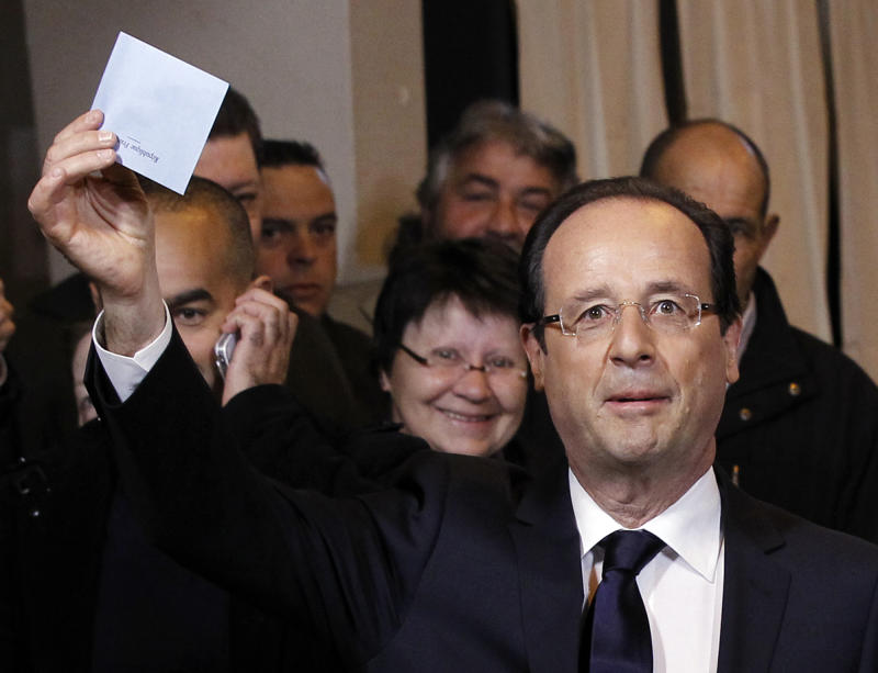 Socialist Party candidate for the presidential election Francois Hollande shows his ballot before voting for the second round in the presidential election in Tulle, central France, Sunday, May 6, 2012.  (AP Photo/Christophe Ena)