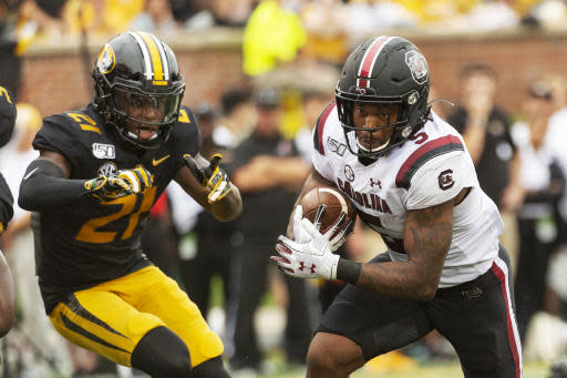 South Carolina running back Rico Dowdle, right, runs past Missouri defensive back Christian Holmes during the second quarter of an NCAA college football game, Saturday, Sept. 21, 2019, in Columbia, Mo. (AP Photo/L.G. Patterson)