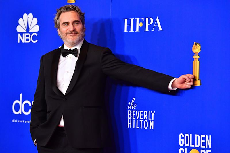 Joaquin Phoenix after winning the award for Best Performance by an Actor in a Motion Picture - Drama during the 77th annual Golden Globe Awards. (Photo by Frederic J. Brown/AFP via Getty Images)