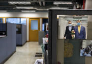 A photo showing Jimmy Lai, right, the founder of Apple Daily is displayed at the news room of Apple Daily Monday, April 26, 2021, in Hong Kong. A newspaper that has advocated for greater democracy in Hong Kong came under further pressure Thursday, June 17, 2021, with the arrests of three top editors and two senior executives.(AP Photo/Vincent Yu)