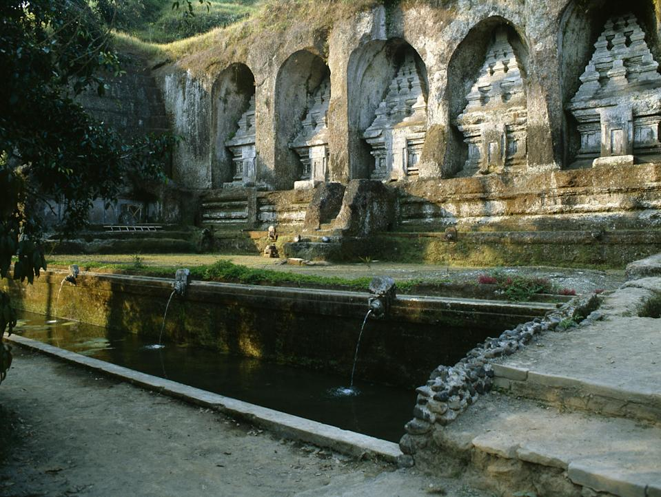 """<p><strong>What's this place all about?</strong><br> Gunung Kawi is an 11th-century complex of courtyards and cliff-carved shrines along the Pakerisan River, near <a href=""""https://www.cntraveler.com/story/finding-the-bali-you-came-for?mbid=synd_yahoo_rss"""" rel=""""nofollow noopener"""" target=""""_blank"""" data-ylk=""""slk:Ubud"""" class=""""link rapid-noclick-resp"""">Ubud</a>. Theories and myths surround the ancient Hindu site—legend has it that a ferocious warrior named Kebo Iwa carved the intricate reliefs with his fingernails, for instance—which adds to its allure. Entry for adults cost around $4, and includes a sarong or sash for adherence to temple dress code.</p> <p><strong>What's it like being there?</strong><br> An archaeological marvel like Gunung Kawi is bound to stir up awe in first-time visitors. The eerie absence of heaving crowds—they're likely nearby at <a href=""""http://www.cntraveler.com/activities/bali/bali/tirta-empul?mbid=synd_yahoo_rss"""" rel=""""nofollow noopener"""" target=""""_blank"""" data-ylk=""""slk:Tirta Empul"""" class=""""link rapid-noclick-resp"""">Tirta Empul</a>—makes it all the more enrapturing.</p> <p><strong>Who comes here?</strong><br> Visitors spend at least an hour or two here delighting in the scenery and rock art, even if it's just to take advantage of visiting a Balinese temple with rare room to roam.</p> <p><strong>Did it meet expectations?</strong><br> Enveloped by terrace rice paddies, natural springs, and verdant hills, the imposing cliff walls feature 10 candis (or shrines) positioned on different sides of the river. Add the lotus-filled ponds and traditional pavilions to the scene, and you have some of the most enchanted river valley settings on the island.</p> <p><strong>What, or who, do you think it's best for?</strong> Getting down to this jungle-enshrouded marvel will require some serious walking (there are some 300 steps), but the reward—especially in the quieter morning hours—is immense.</p>"""