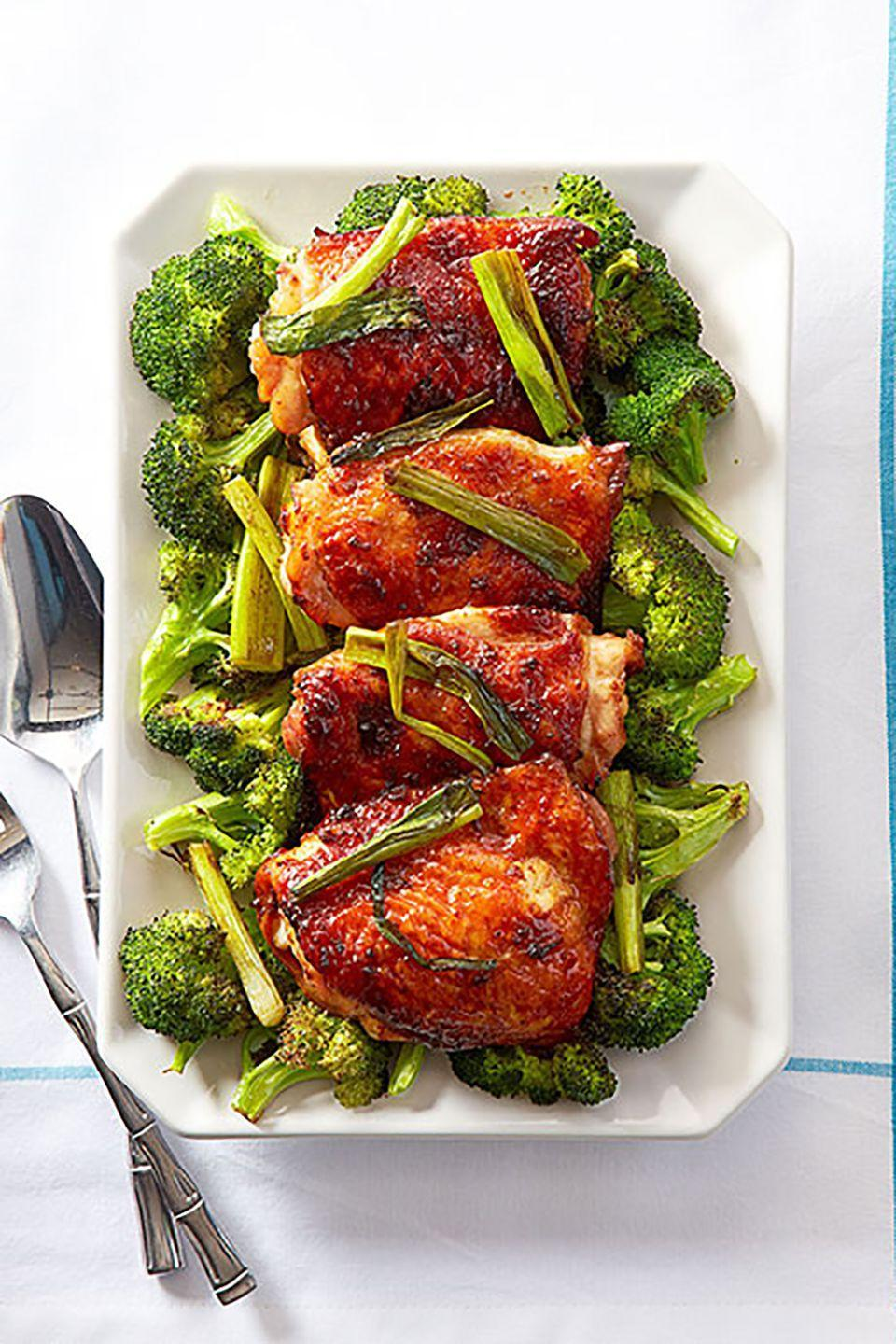 "<p>A glaze of soy and honey gives this dish its rich color and caramelized flavor.</p><p><strong><a href=""https://www.countryliving.com/food-drinks/recipes/a24567/mahogany-chicken-broccoli-recipe-ghk0315/"" rel=""nofollow noopener"" target=""_blank"" data-ylk=""slk:Get the recipe."" class=""link rapid-noclick-resp"">Get the recipe.</a></strong><br></p><p><a class=""link rapid-noclick-resp"" href=""https://www.amazon.com/dp/B0026RHI3M?tag=syn-yahoo-20&ascsubtag=%5Bartid%7C10050.g.680%5Bsrc%7Cyahoo-us"" rel=""nofollow noopener"" target=""_blank"" data-ylk=""slk:SHOP BAKING SHEETS"">SHOP BAKING SHEETS</a> </p>"