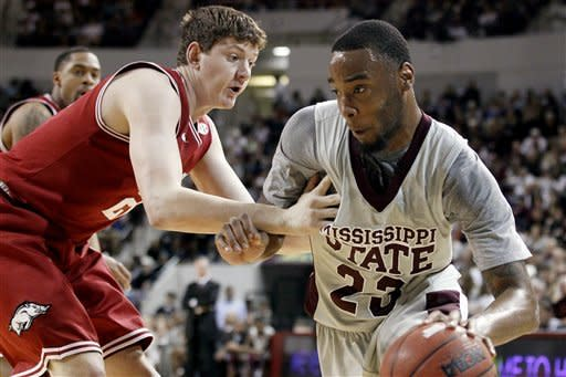 Arkansas forward Hunter Mickelson (21) pressures Mississippi State forward Arnett Moultrie (23) during the first half of their NCAA college basketball game, Saturday, March 3, 2012, in Starkville, Miss. (AP Photo/Rogelio V. Solis)