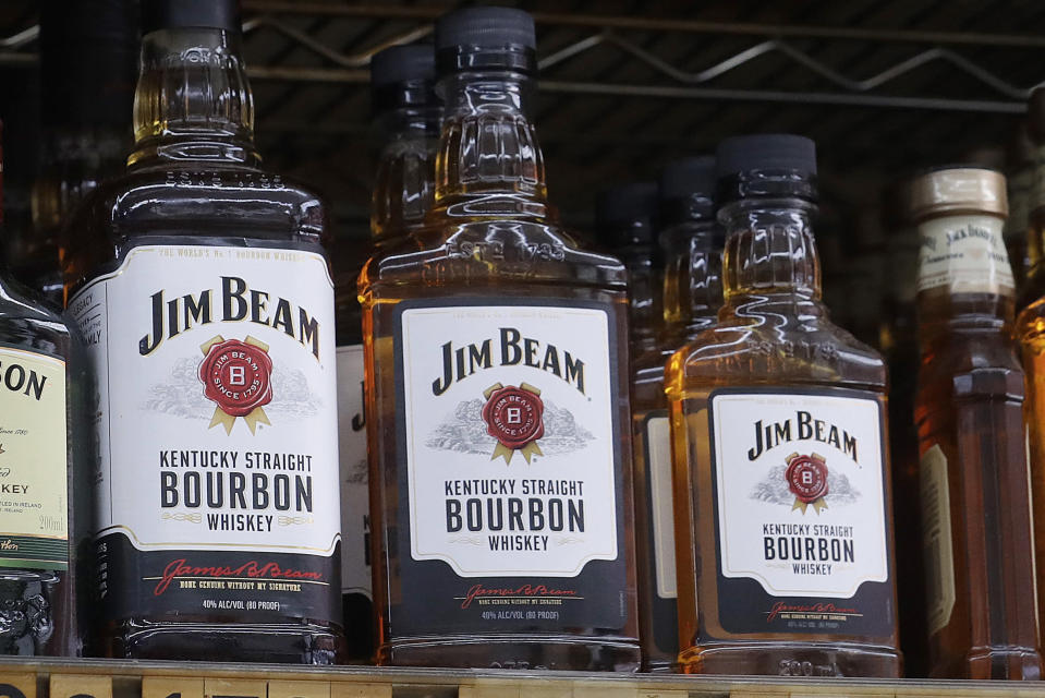FILE - In this July 9, 2018 file photo, bottles, Jim Beam are displayed at Rossi's Deli in San Francisco. The European Union and the United States have decided to temporarily suspend measures at the heart of a steel tariff dispute that is seen as one of the major trade issues dividing the two sides. When Trump imposed the tariffs, Europe retaliated by raising tariffs on U.S.-made motorcycles, bourbon, peanut butter and jeans, among other items. (AP Photo/Jeff Chiu, File)