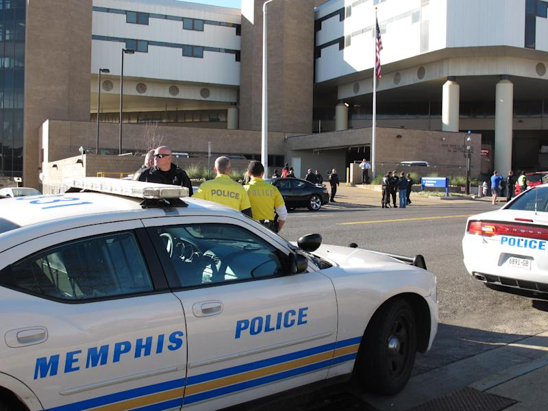 Memphis Police Department officers gather outside the Regional Medical Center after two of their fellow officers were involved in a shooting on Friday, Dec. 14, 2012 in Memphis, Tenn. One officer was killed and another officer was wounded. The wounded officer was being treated at the medical center. (AP Photo/Adrian Sainz)