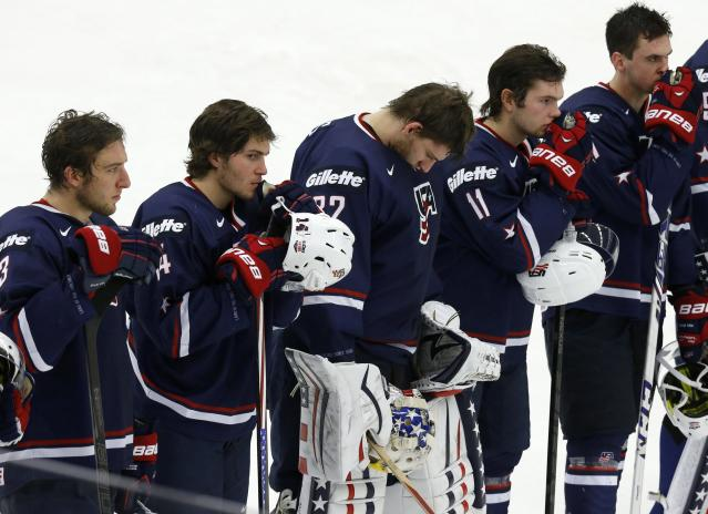 U.S. players react after their loss to Russia in their IIHF Ice Hockey World Championship quarter-final match in Malmo