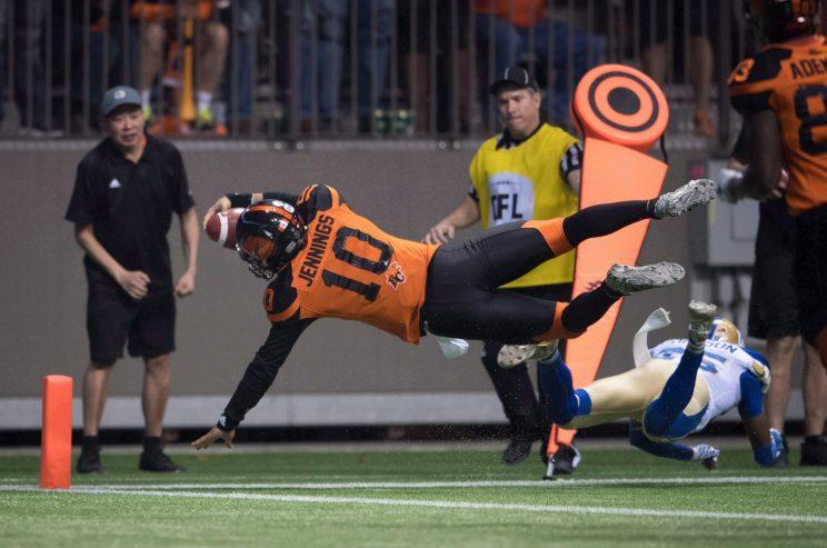 B.C. Lions quarterback Jonathon Jennings dives into the end zone for the winning touchdown against Winnipeg on Nov. 13, 2016. (THE CANADIAN PRESS/Darryl Dyck Photo)