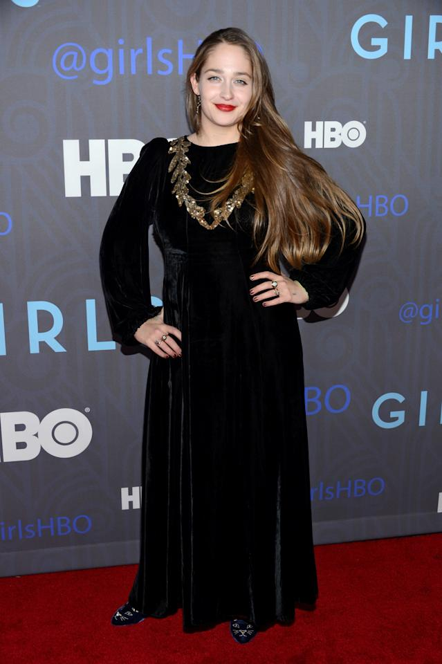 <p>At the season two premiere of <em>Girls,</em> Kirke opted for a black velvet maxi dress with a gold collar detail, striking a balance between bohemian and Renaissance in New York, New York, January 2013.</p>