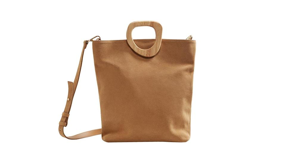"""<p>We told you Mango was the place to shop this season. We have our hearts set on this suede shopper. <em><a href=""""https://shop.mango.com/gb/women/bags-shoppers/wooden-handle-leather-bag_23045720.html?c=CU&n=1&s=accesorios.accesorio;40,340,440"""" rel=""""nofollow noopener"""" target=""""_blank"""" data-ylk=""""slk:Mango"""" class=""""link rapid-noclick-resp"""">Mango</a>, £49.99</em> </p>"""