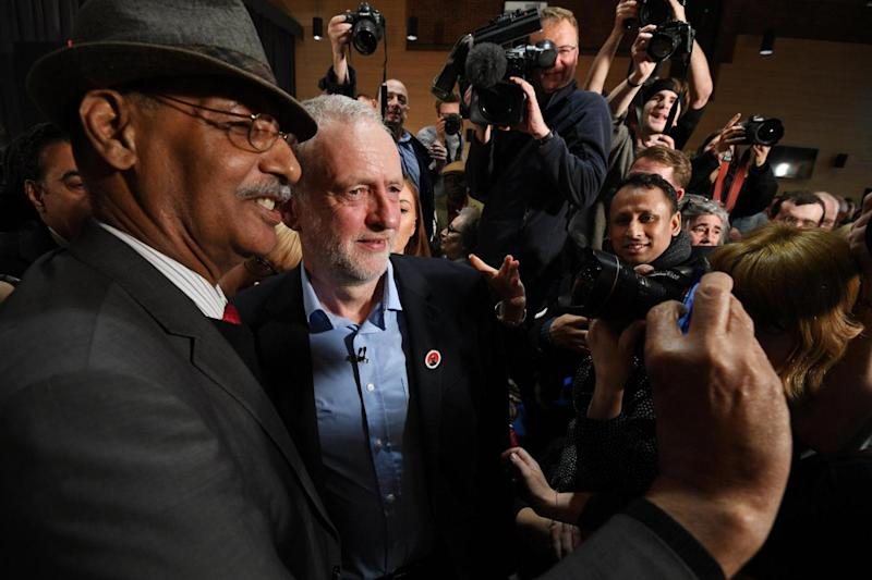 Support: Corbyn has his photograph taken as he leaves after speaking to supporters at Wash House during the London rally (EPA)