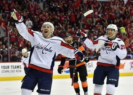 Mar 24, 2019; Washington, DC, USA; Washington Capitals center Travis Boyd (left) celebrates after scoring a goal against the Philadelphia Flyers during the second period at Capital One Arena. Mandatory Credit: Brad Mills-USA TODAY Sports