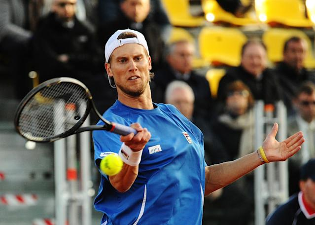Italy's Andreas Seppi returns the ball to Britain's Andy Murray during their Davis Cup World Group quarterfinal match in Naples, Italy, Friday, April 4, 2014. (AP Photo/Salvatore Laporta)