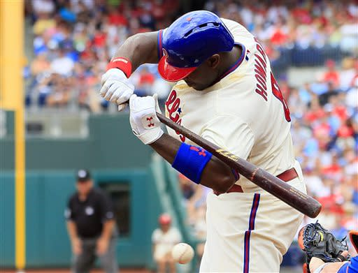 Philadelphia Phillies' Ryan Howard leans from an inside pitch during the second inning of a baseball game with the New York Mets, Sunday, June 23, 2013, in Philadelphia. (AP Photo/Tom Mihalek)