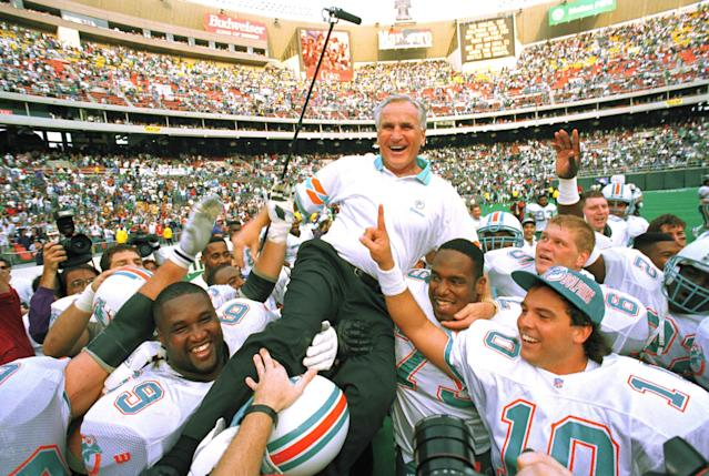 Don Shula is carried off the field after winning his 325th career game to become the NFL's winningest coach. (AP)