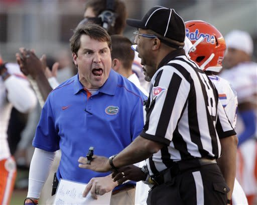 Florida head coach Will Muschamp, left, has words with head linesman Arthur Hardin during the first half of an NCAA college football game against Florida State, Saturday, Nov. 24, 2012, in Tallahassee, Fla. (AP Photo/John Raoux)