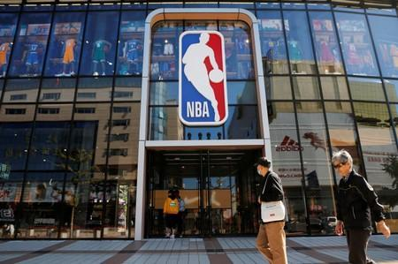 FILE PHOTO: People enter a flagship NBA store at the Wangfujing shopping street