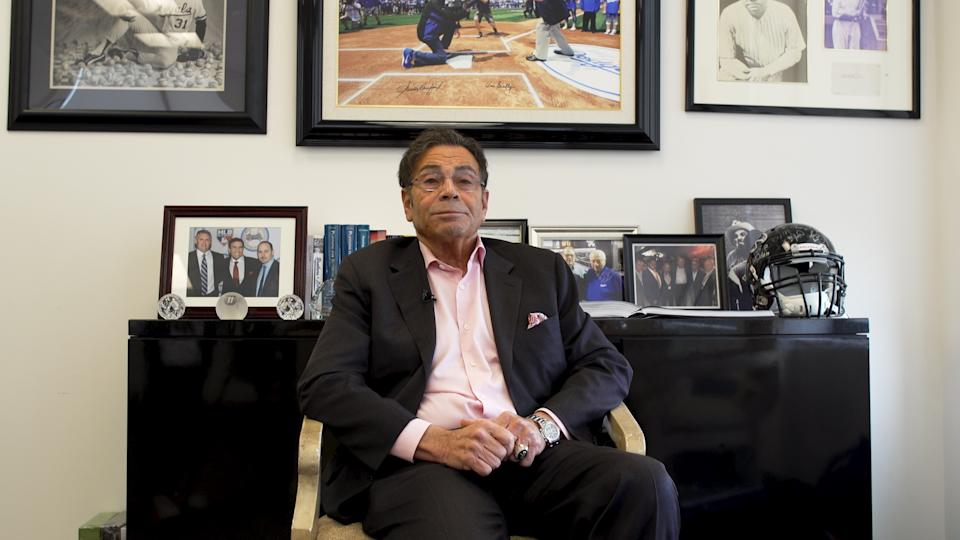 Dennis Gilbert sitting in his The Gilbert Group insurance office in Beverly Hills, California.