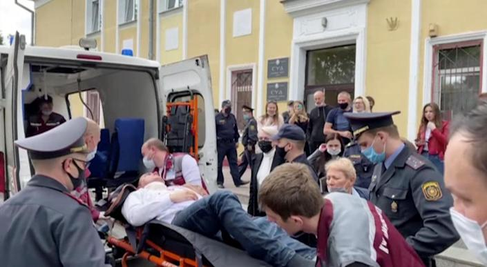 A still image taken from video footage shows Belarusian prisoner Stepan Latypov, who was arrested during a security crackdown on mass protests following a contested presidential election in 2020, being carried out of a court building after he stabbed himself in Minsk, Belarus, June 1, 2021. / Credit: Radio Free Europe/Radio Liberty/Handout via Reuters TV