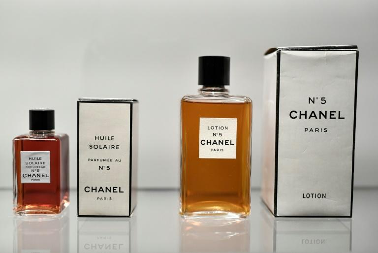 Her Chanel No. 5 perfume, sold in simple square bottles with utilitarian black and ivory labels, was minimalist before minimalism was even a thing