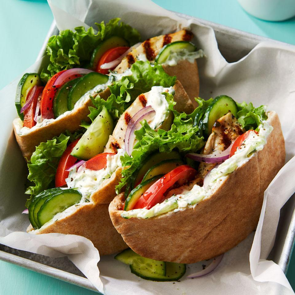 "<p>Cucumbers do double duty in this healthy Greek chicken pita recipe--they're grated to lend a refreshing flavor to the quick cucumber-yogurt sauce and sliced to provide cool crunch tucked into the pita. Serve these Mediterranean sandwiches for a healthy dinner or light lunch. <a href=""http://www.eatingwell.com/recipe/273182/greek-chicken-cucumber-pita-sandwiches-with-yogurt-sauce/"" rel=""nofollow noopener"" target=""_blank"" data-ylk=""slk:View recipe"" class=""link rapid-noclick-resp""> View recipe </a></p>"