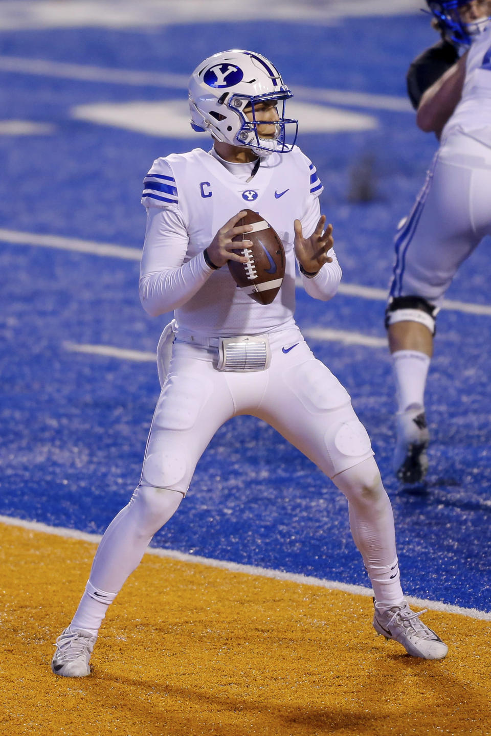 BYU quarterback Zach Wilson (1) looks for a receiver during the first half of the team's NCAA college football game against Boise State on Friday, Nov. 6, 2020, in Boise, Idaho. (AP Photo/Steve Conner)