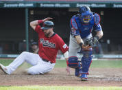 Cleveland Indians' Jason Kipnis scores as Texas Rangers' Jeff Mathis takes the throw from Nomar Mazara during the seventh inning of the second game of a baseball doubleheader in Cleveland, Wednesday, Aug. 7, 2019. (AP Photo/Phil Long)