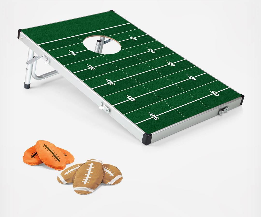 "<p>This portable bean bag toss is the perfect gift for indoor and outdoor fun-he can play individually or open it up to a group.</p><p>$90 | <a rel=""nofollow"" href=""https://www.zola.com/shop/product/picnictime_bean_bag_toss_travel_set?skuId=58b8b00262906c02be23e393&collectionItemId=58b8b5d562906c02be23e3a0&utm_source=InStyle&utm_campaign=Gifts_Grooms_Love&utm_medium=Referral"">SHOP IT</a></p>"