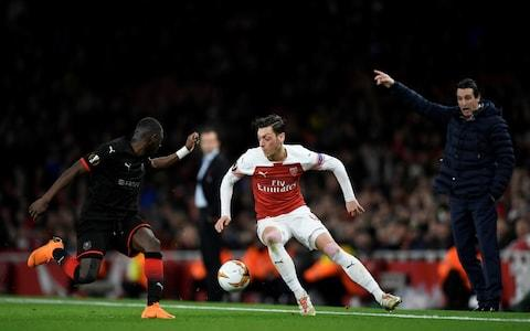 Stade Rennes' Hamari Traore in action with Arsenal's Mesut Ozil  - Credit: REUTERS