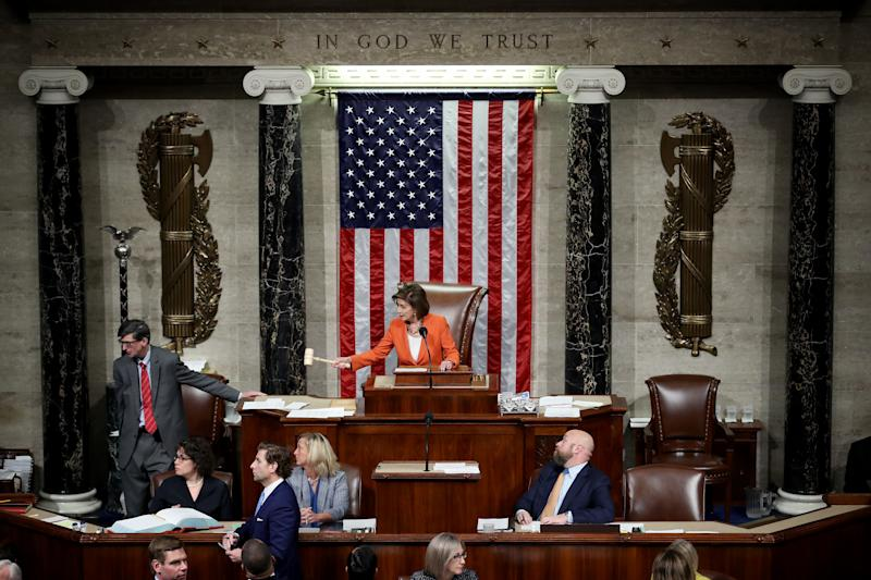 House Speaker Nancy Pelosi gavels the close of a vote on a resolution formalizing the impeachment inquiry into President Trump on Thursday. (Photo by Win McNamee/Getty Images)