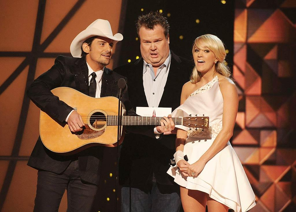 "Publicity addict Kim Kardashian got a little attention she probably <i>didn't</i> want during Wednesday night's 45th annual CMA Awards in Nashville, where (L-R) Brad Paisley, Eric Stonestreet, and Carrie Underwood belted out an original tune about the reality star. ""I'm going to love you forever, or 72 days Amen, as long as Justin Bieber is not a conceiver, as long as Taylor Swift is with her current boyfriend,"" the three sang. ""I'm going to love you for 20 million dollars, for a hit TV series or pics in Us Weekly, for 72 Days, Amen."" (11/9/2011)"