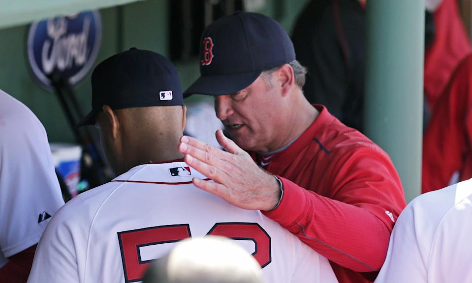 Boston Red Sox starting pitcher Eduardo Rodriguez gets a pat on the back from manager John Farrell after facing the Minnesota Twins during the seventh inning in the first baseball game of a doubleheader at Fenway Park in Boston, Wednesday, June 3, 2015. Rodriguez gave up one run on two hits in the game. (AP Photo/Charles Krupa)