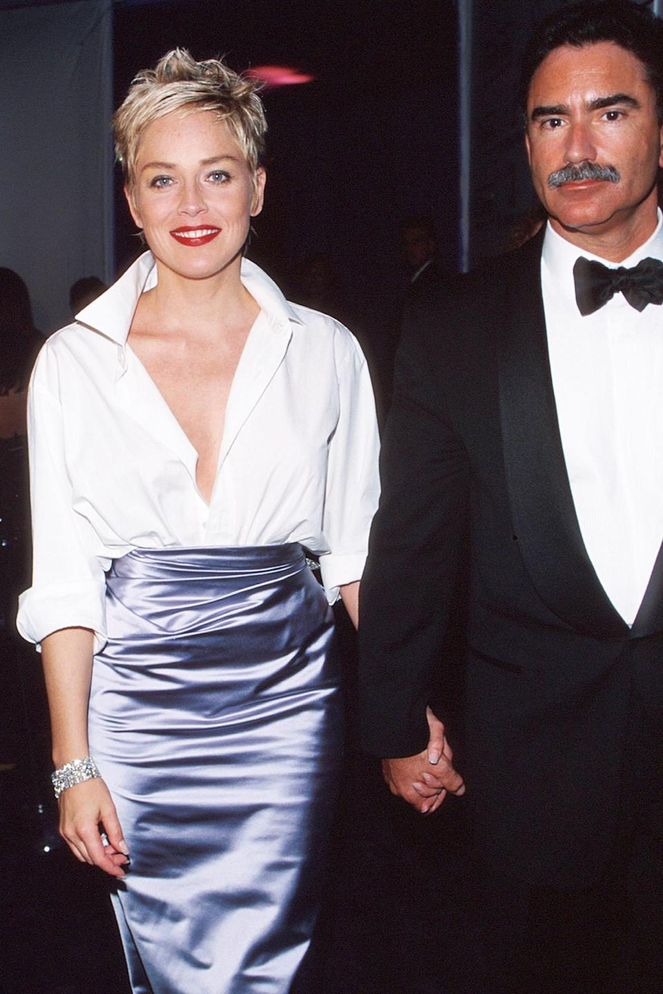 """<h2>Sharon Stone, 1998<br></h2><br>We would normally advise against wearing Gap at the Oscars — but when it's combined with Vera Wang and draped on Sharon Stone, it's hard <em>not</em> to be convinced that the casual brand right where it belongs.<br><br><em>Sharon Stone in Gap and Vera Wang.</em><span class=""""copyright"""">Photo: Mychal Watts/WireImage/Getty Images. </span>"""