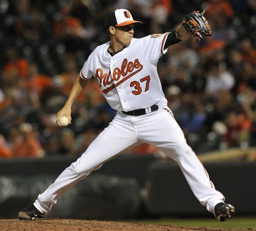 Baltimore Orioles pitcher Kevin Gausman delivers against the Boston Red Sox in the sixth inning of a baseball game Thursday, June 13, 2013 in Baltimore. (AP Photo/Gail Burton)