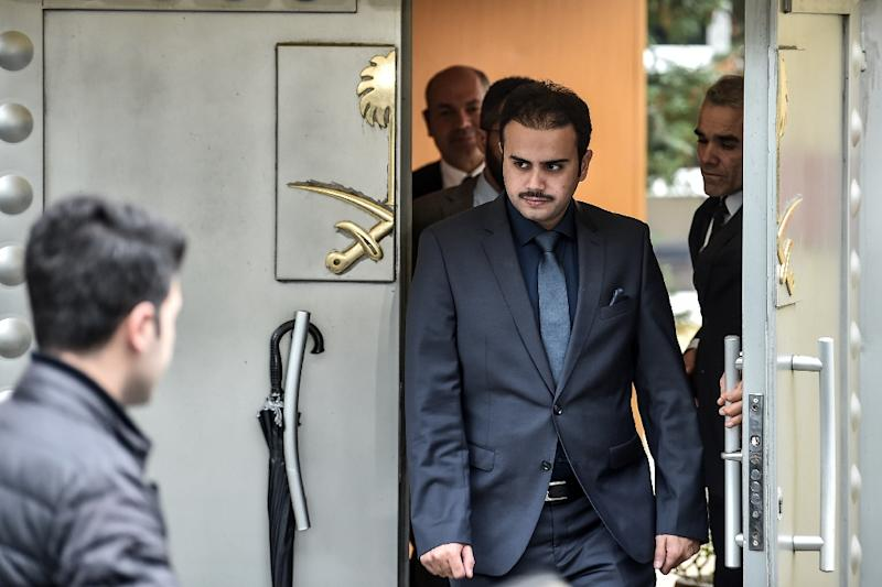 People leave the Saudi Arabian consulate in Istanbul ahead of an expected search of the building by Turkish investigators