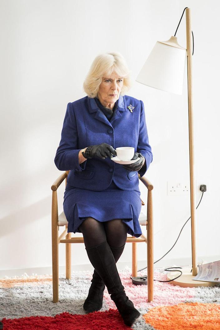 <p>Camilla visited Maggie's Centre, an organization she supports which provides emotional support for people affected by cancer. For this meeting, Camilla chose a blue skirt suit, paired with black gloves, a colorful brooch, and black, suede boots. </p>