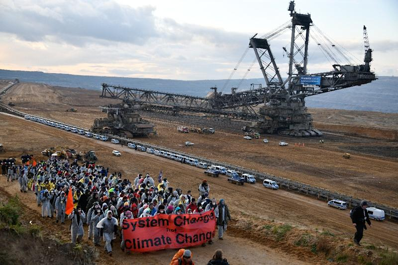 Environmentalists demonstrated at the Hambach open pit lignite coal mine near Elsdorf in western Germany last year to protest the continued use of fossil fuels and its contribution to global warming