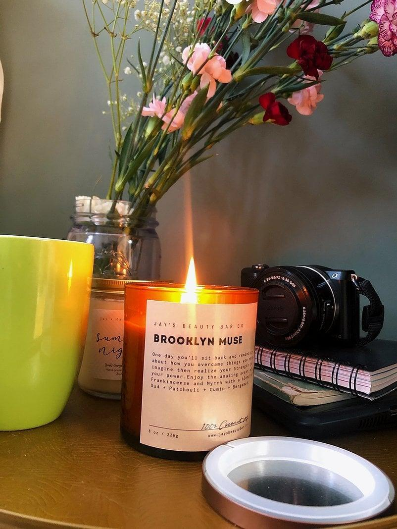 """<p><span>Jay's Beauty Bar Brooklyn Muse Candle</span> ($25) </p> <p>""""I'm all about giving coziness this season and I love these natural candles from Jay's Beauty Bar, a Brooklyn-based, Black woman-owned business. The scents are deeply relaxing and so fragrant that just having the candle open sets the mood! I light one before meditating!"""" - Nneya Richards, contributing editor</p>"""