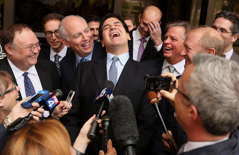 Mark Cuban, billionaire owner of the NBA Dallas Mavericks basketball team, center, laughs while speaking to the media after exiting federal court in Dallas, Texas, U.S., on Wednesday, Oct. 16, 2013. Cuban didn't engage in insider trading nine years ago, a federal jury decided in a case brought by the U.S. Securities and Exchange Commission (SEC). Photographer: Mike Fuentes/Bloomberg via Getty Images