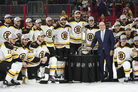 May 16, 2019; Raleigh, NC, USA; Boston Bruins players celebrate with the Prince of Wales trophy and NHL deputy commissioner Bill Daly after defeating the Carolina Hurricanes in game four of the Eastern Conference Final of the 2019 Stanley Cup Playoffs at PNC Arena. The Boston Bruins defeated the Carolina Hurricanes 4-0. Mandatory Credit: James Guillory-USA TODAY Sports